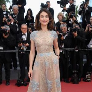 "Olga Kurylenko attended the ""The Meyerowitz Stories"" screening  during the 70th annual Cannes Film Festival  wearing a blush and sky blue embroidered tulle short-sleeved gown  from the ELIE SAAB Haute Couture Spring-Summer 2017 collection."