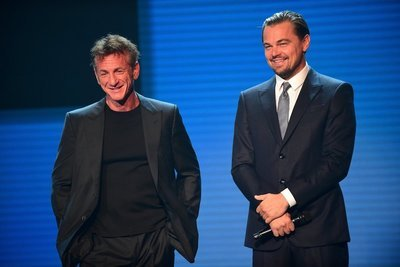 SAINT-TROPEZ, FRANCE - JULY 26: (L-R) Sean Penn Leonardo DiCaprio are seen on stage the Leonardo DiCaprio Foundation 4th Annual Saint-Tropez Gala at Domaine Bertaud Belieu on July 26, 2017 in Saint-Tropez, France.  (Photo by Anthony Ghnassia/Getty Images for LDC Foundation) *** Local Caption *** Sean Penn;Leonardo DiCaprio