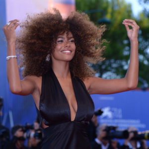 "Model Tina Kunakey attends the premiere of the movie ""Mother"" presented in competition at the 74th Venice Film Festival on September 5, 2017 at Venice Lido.  / AFP PHOTO / Filippo MONTEFORTE        (Photo credit should read FILIPPO MONTEFORTE/AFP/Getty Images)"