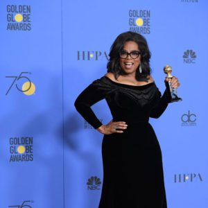 BEVERLY HILLS, CA - JANUARY 07:  Oprah Winfrey poses with the Cecil B. DeMille Award in the press room during the 75th Annual Golden Globe Awards at The Beverly Hilton Hotel on January 7, 2018 in Beverly Hills, California.  (Photo by Venturelli/WireImage)